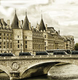 La Conciergerie Paris France With Gothic Turrets. La Conciergerie in Paris. Ancient historic landmark was a prison used in the days of the French Revolution and Royalty Free Stock Photos