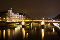 La Conciergerie and Pont au Change at nigh Royalty Free Stock Photography