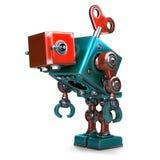 La conclusione ha sovraccaricato il robot con la chiave che conficca il suo indietro Isolato Contiene il percorso di ritaglio Fotografia Stock Libera da Diritti