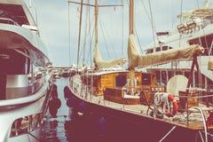 LA CONDAMINE, MONACO - JUNE 04, 2019: Yachts docked at Port Hercules in La Condamine harbour. Cityscape of Monte Carlo. stock image