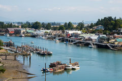 La Conner Washington Waterfront and Swinomish Fishing Port. LA CONNER, WA-AUG 16, 2015: Aerial view of Swinomish Channel with Swinomish Indian Reservation stock photography