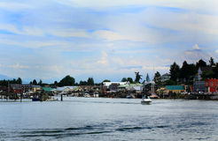 La Conner Waterfront. View of La Conner Washington waterfront under white clouds & blue skies Stock Photos