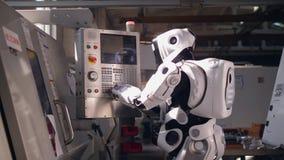 La console sta azionanda da un cyborg stock footage