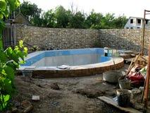 La construcción de la piscina Imagen de archivo