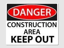 La construction de danger se connectent un fond gris Photographie stock