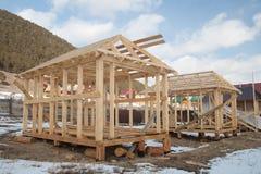 La construction des maisons de panneau Photographie stock libre de droits