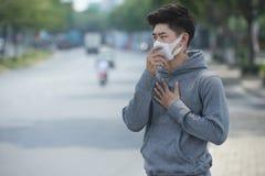 La contaminación atmosférica causa asma Fotografía de archivo