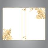 La copertina di libro è bianca con l'ornamento dell'oro su un fone grigio Immagine Stock