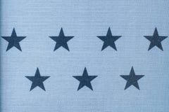 La copie de timbre d'étoile sur le tissu de blues-jean de denim, se ferment, fond de mode Image libre de droits