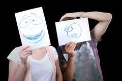 La coppia con caricatura sorride pitture degli occhi delle tazze Immagine Stock Libera da Diritti