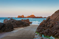 La Corbiere Lighthouse Jersey at sunrise and high tide stock photos