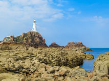 La Corbiere Lighthouse on the rocky coast of Jersey Island Stock Photography