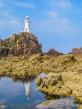 La Corbiere Lighthouse on the rocky coast of Jersey Island Stock Images