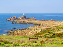 La Corbiere Lighthouse on the rocky coast of Jersey Island Royalty Free Stock Image
