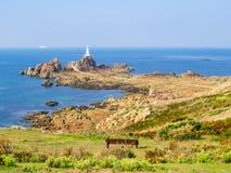 La Corbiere Lighthouse on the rocky coast of Jersey Island Royalty Free Stock Image