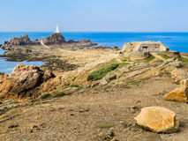 La Corbiere Lighthouse on the rocky coast of Jersey Island Royalty Free Stock Images