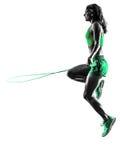 La corde à sauter de forme physique de femme exerce la silhouette photos stock