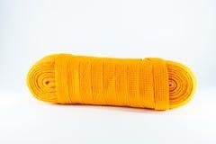 La corde orange roule à plat Photo libre de droits