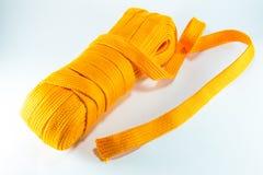 La corde orange roule à plat Image libre de droits