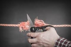 La corde rouge est coupée Photographie stock libre de droits