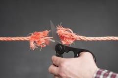 La corde rouge est coupée Images stock