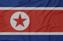 La Corea del Nord ha corrugato la bandiera immagini stock