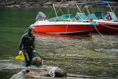 LA COREA DEL SUD - 19 MAGGIO 2018: Donna-operatori subacquei tradizionali all'isola di Jeju, anche chiamata come Haenyeo, riunent fotografie stock