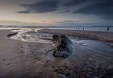 La corrente attraverso la spiaggia Immagine Stock