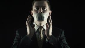 La corrupción, la persona en un traje cerró una boca por el dólar de EE. UU. metrajes