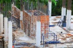 La costruzione di alloggio del posto di lavoro dei lavori di costruzione con lo spazio della copia aggiunge il testo Immagine Stock