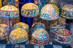 La costura adornó los casquillos Imagenes de archivo