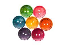 La costura formada circular redonda de diverso color abotona en una flor Imágenes de archivo libres de regalías