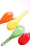 La couleur administre l'épice à la cuillère Photos stock