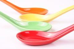 La couleur administre l'épice à la cuillère Image stock