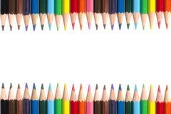 La couleur crayonne la vue sur le fond blanc Photo stock