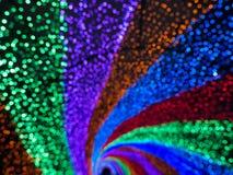 La couleur en spirale allume le fond Photo libre de droits