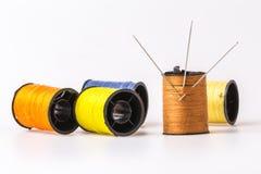 La couture de broderie d'aiguille de couture a roulé dans le brun Photo stock