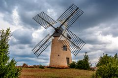 Windmill inLa Couvertoirade a Medieval town in Aveyron, France royalty free stock image