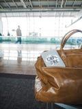 La couverture de sac et de passeport avec le ` de motivation de citation explorent le ` Photographie stock