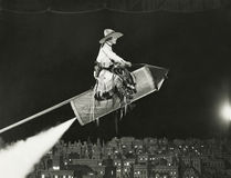 La cow-girl décolle sur une fusée Photo stock