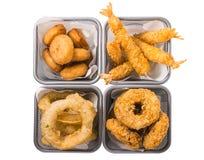 La cozza, gamberetti, anello di cipolla, anello del calamaro, frigge nel grasso bollente Fotografia Stock Libera da Diritti