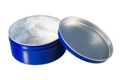 La crème vide bleue peut d'isolement sur le blanc Image libre de droits