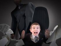 La crainte d'homme de petite entreprise a fait un pas dessus image stock