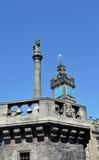 La cruz de Mercat, Glasgow, Escocia, con la aguja b de Tolbooth Foto de archivo libre de regalías