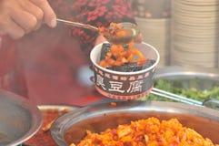 la cuajada de habichuelas preservada Fuerte-que olía/fermentó la cuajada de habichuelas con la cuajada del olor/de habichuelas co imagen de archivo libre de regalías