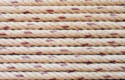 La cuerda náutica raya el fondo Imagen de archivo
