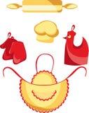 La cuisine vêtx, tablier, gants, goupille Photos stock