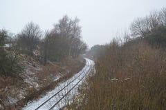 La curva del carril del invierno Fotos de archivo libres de regalías