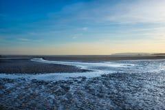 La curvatura insabbia il Spiaggia-crepuscolo immagine stock