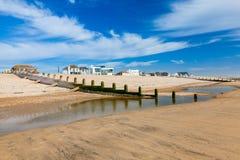 La curvatura insabbia la spiaggia Inghilterra Regno Unito Fotografie Stock Libere da Diritti